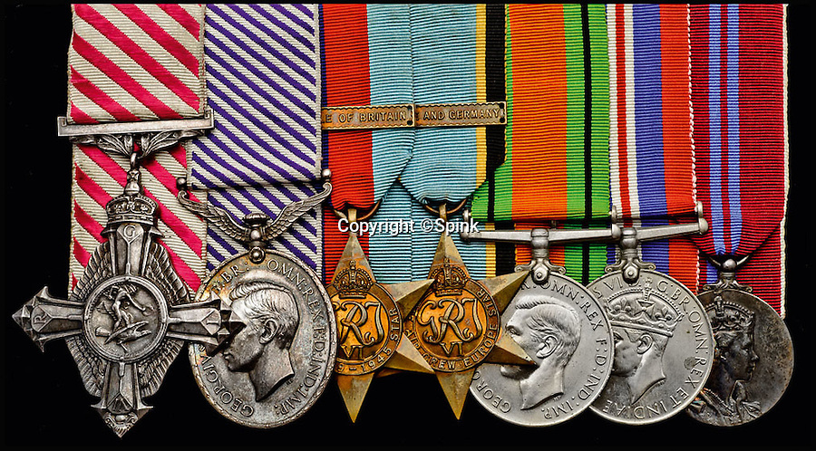 BNPS.co.uk (01202 558833)<br /> Pic: Spink/BNPS<br /> <br /> ***Please Use Full Byline***<br /> <br /> (L-R): Air Force Cross, G.VI.R., Distinguished Flying Medal, G.VI.R., 1939 - 1945 Star, with Battle of Britain Bar, Air Crew Europe Star, Defence and War Medals, Coronation 1953.<br /> <br /> <br /> The remarkable story of a prolific RAF hero who achieved 'ace' status in just two-and-a-half hours of flying has come to light after his medals were put up for sale.<br /> <br /> Squadron Leader Ronald Fairfax Hamlyn went up in his Spitfire three times on August 24, 1940, at the very height of the Battle of Britain.<br /> <br /> He was awarded the Distinguished Flying Medal which, along with the rest of his medals, is being sold in London for an estimated &pound;60,000.