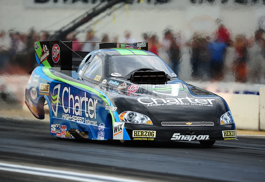 Aug. 19, 2011; Brainerd, MN, USA: NHRA funny car driver Tony Pedregon during qualifying for the Lucas Oil Nationals at Brainerd International Raceway. Mandatory Credit: Mark J. Rebilas-