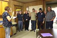 MEGAN DAVIS/MCDONALD COUNTY PRESS On Monday, April 29, County Clerk Kimberly Bell swore-in the Board of Directors for the White Rock Fire Protection District. From L to R: Joe Lahr, Dan Moore, Erwin Brandenburg, Shawn Moore and Ray Bratton.