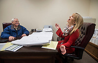 NWA Democrat-Gazette/BEN GOFF @NWABENGOFF<br /> Channing Barker, Benton County communications director, meets with John W. Sudduth, Benton County administrator of general services, Thursday, Dec. 28, 2017, in his office at the Benton County Administration Building in downtown Bentonville.