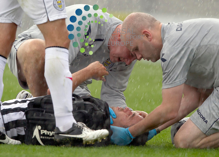 Dougie Imrie of St Mirren is knocked out during the St Mirren v inverness  at St Mirren Park.Picture: Maurice McDonald/Universal News And Sport (Europe). 4 August  2012. www.unpixs.com.