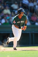 Third baseman Rafael Devers (13) of the Greenville Drive runs toward first base in a game against the Charleston RiverDogs on Sunday, June 28, 2015, at Fluor Field at the West End in Greenville, South Carolina. Devers is the No. 6 prospect of the Boston Red Sox, according to Baseball America. Charleston won, 12-9. (Tom Priddy/Four Seam Images)