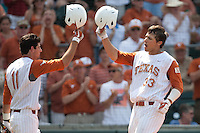 Texas Longhorns outfielder Jonathan Walsh #33 celebrates with teammate Alex Silver #11 after his home run during the NCAA baseball game against the Texas A&M Aggies on April 28, 2012 at UFCU Disch-Falk Field in Austin, Texas. The Aggies beat the Longhorns 12-4. (Andrew Woolley / Four Seam Images).