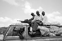 North Darfur, August 13, 2004.Janjaweed militiamen returning to their Masteriya district home.