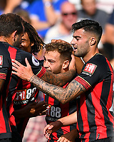 Ryan Fraser of AFC Bournemouth is mobbed after scoring the first goal during AFC Bournemouth vs Leicester City, Premier League Football at the Vitality Stadium on 15th September 2018