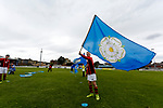 Young fans waving the Yorkshire flag. Yorkshire v Parishes of Jersey, CONIFA Heritage Cup, Ingfield Stadium, Ossett. Yorkshire's first competitive game. The Yorkshire International Football Association was formed in 2017 and accepted by CONIFA in 2018. Their first competative fixture saw them host Parishes of Jersey in the Heritage Cup at Ingfield stadium in Ossett. Yorkshire won 1-0 with a 93 minute goal in front of 521 people. Photo by Paul Thompson