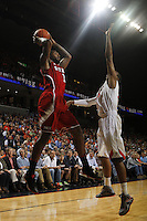 North Carolina State forward Richard Howell (1) passes the ball over Virginia forward Akil Mitchell (25) during the game Saturday in Charlottesville, VA. Virginia defeated NC State 58-55.