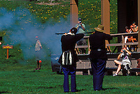 REENACTORS FIRE MUSKETS ON THE PARADE GROUNDS OF FORT MACKINAC ON MACKINAC ISLAND, MICHIGAN.