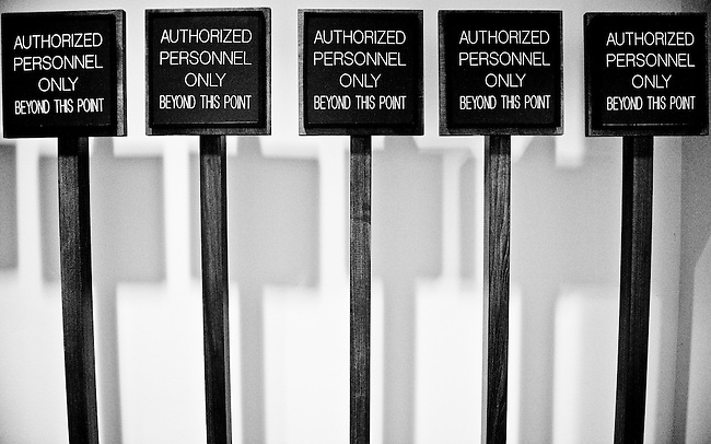"""""""Authorized Personnel Only"""" signs stand in a back hallway of the Hart 216 hearing room as the Senate Finance Committee's markup of """"The America's Health Future Act"""" continues on Sept. 25, 2009."""