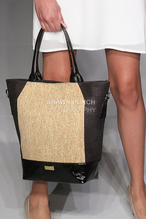 Detail of model walking runway with a handbag from the Uniquely Fall Winter 2016 collection, at the Designer's Collective Fall Winter 2016 runway show for Fashion Gallery New York Fall 2016, during New York Fashion Week Fall 2016.