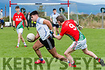 Michael Joe O'Driscoll of St. Michael's, Foilmore attempts to dispossess Aiden Crean of Annascaul in the final of The Cahill Cup at Cromane pitch on Saturday.