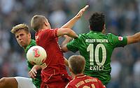 FUSSBALL   1. BUNDESLIGA   SAISON 2012/2013   LIGA TOTAL CUP  FC Bayern Muenchen - SV Werder Bremen       04.08.2012 Niclas Fuellkrug (li) und Mehmet Ekici (re, beide SV Werder Bremen) gegen Bastian Schweinsteiger (2. v.l. Bayern Muenchen)