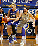 BROOKINGS, SD - NOVEMBER 18:  Taylor Johnson #22 from Creighton tries to control the ball as Ellie Thompson #45 from South Dakota State University applies pressure in the first half of their game Tuesday night at Frost Arena in Brookings. (Photo by Dave Eggen/Inertia)