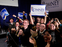 Mitt Romney supporters erupt upon learning that Romney has taken a slight lead over Rick Santorum as results come in after the Iowa caucus Tuesday, January 3, 2012 in Des Moines, Iowa.  (Christopher Gannon/GannonVisuals.com/MCT)