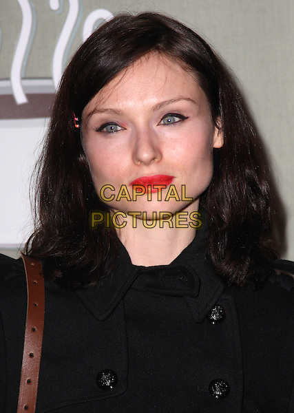 SOPHIE ELLIS-BEXTOR .Attending the Central Perk Launch Party, Carnaby Street, London, England, UK,.September 23rd 2009..portrait headshot red lipstick make-up black eyeliner hair clip accessory .CAP/JIL.©Jill Mayhew/Capital Pictures