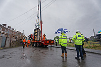 Pictured: The Banksy is hoisted with a crane onto a flat bed lorry. Wednesday 29 May 2019<br /> Re: Contractors are working to move Banksy's Season Greeting, now owned by John Brandler, which appeared on a garage wall in Port Talbot, to a new location in the same town in south Wales, UK.