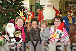 Admiring the Christmas Display at Kenmare shopping center on Friday Aoife Daly, Lisa O'Brien, Vaughan O'Brien and Aine Lynch.