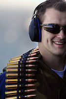 "071020-N-7981E-365 PACIFIC OCEAN (October 20, 2007)-Gunner's Mate 3rd Class Dustin Waggener celebrates a successful .50 Caliber machine gun target engagement following a ""killer barrel"" exercise on the fantail of the Nimitz-class aircraft carrier USS Abraham Lincoln (CVN 72). Lincoln is underway for a scheduled work up to include Composite Training Unit Exercise (COMTUEX), an exercise designed to enhance the interoperability of the carrier and its strike group. U.S. Navy photo by Mass Communication Specialist 3rd Class James R. Evans (RELEASED)"