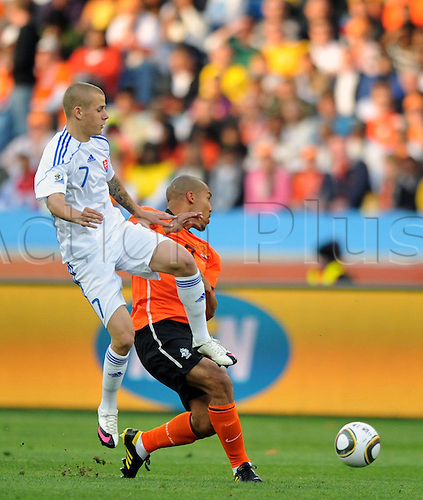 28 06 2010   Slovakias Vladimir White Top vies The Ball during The 2010 World Cup Round of 16 Soccer Match Against The Netherlands at Moses Mabhida Stadium in Durban South Africa