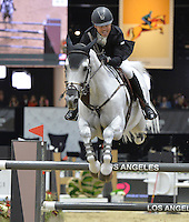 Kent Farrington (USA), riding Willow at the Gucci Gold Cup International Jumping competition at the 2015 Longines Masters Los Angeles at the L.A. Convention Centre.<br /> October 3, 2015  Los Angeles, CA<br /> Picture: Paul Smith / Featureflash