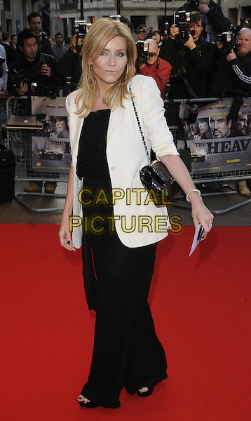 MICHELLE COLLINS.World Premiere of 'The Heavy' at the Odeon West End, Leicester Square, London, England, UK..April 15th 2010 .full length white jacket black chanel bag trousers catsuit jumpsuit blazer.CAP/CAN.©Can Nguyen/Capital Pictures.