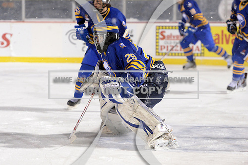 Buffalo Junior Sabres goalie Joseph Pianta (29) during a game against the St. Michaels Buzzers at the Frozen Frontier outdoor game at Frontier Field on December 15, 2013 in Rochester, New York.  St. Michael's defeated Buffalo 5-4.  (Copyright Mike Janes Photography)