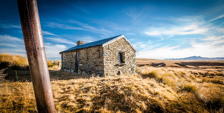 Panorama of historic stone building at Potters on the Old Man Range. Central Otago New Zealand.