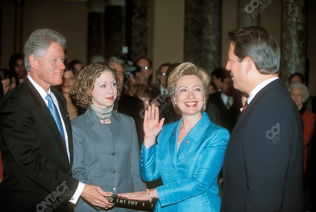 Hillary Clinton, with her husband, Bill Clinton, and daughter, Chelsea, being sworn in by Al Gore as Senator from New York. Washington, DC January 2001