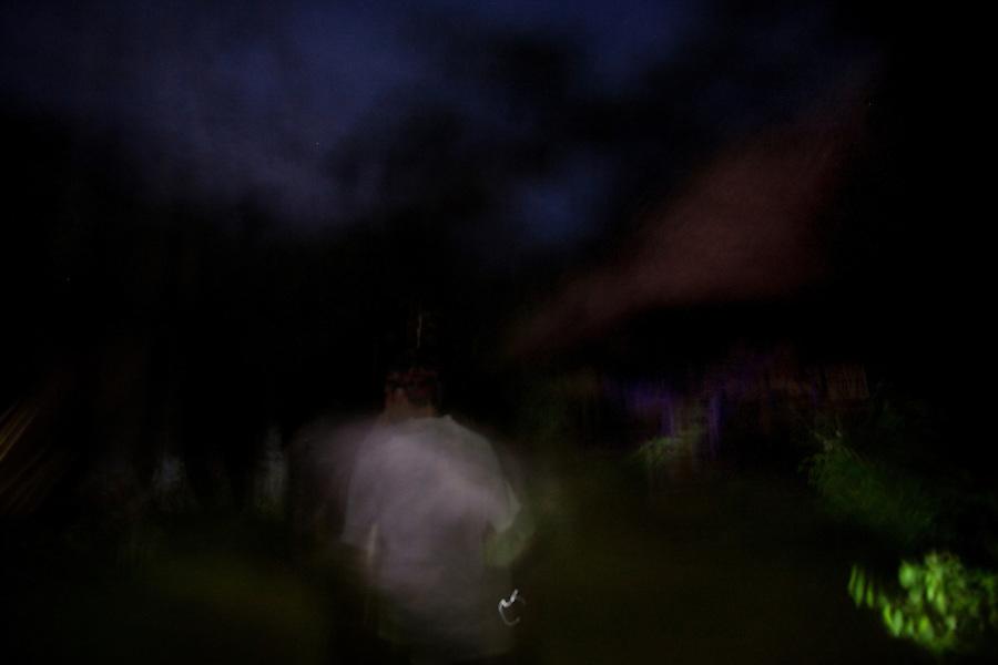 Iquitos, Peru, September 13, 2013 - Single exposure portrait of guide Wellington walking through the jungle.