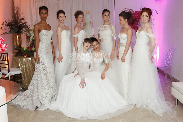 Models pose in wedding dresses from the Pas de Deux Bridal collection at the With This Ring event, host by Menagerie and Punto Space, at 325 West 38th street in New York City, during New York Bridal Fashion Week Spring Summer 2017.