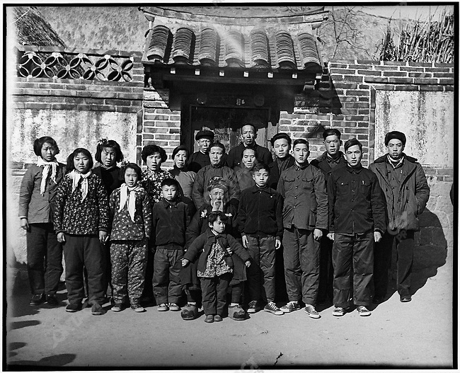 Pg 21 - Family picture taken by Li (fifth from right) with his 4.5 x 6 camera set on self-timer. Li's grandfather Li Xingcun is seated in the center. Lidao commune, Rongcheng county, Shangdong Province. 18 February 1958