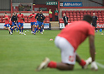 Players of Aldershot Town warming up prior to their League 2 fixture against Crewe Alexandra at the Alexandra Stadium. The visitors won by 2 goals to 1.