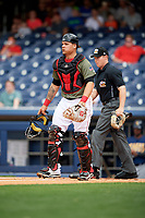Nashville Sounds catcher Bruce Maxwell (36) and home plate umpire Junior Valentine during a game against the New Orleans Baby Cakes on April 30, 2017 at First Tennessee Park in Nashville, Tennessee.  The game was postponed due to inclement weather in the fourth inning.  (Mike Janes/Four Seam Images)