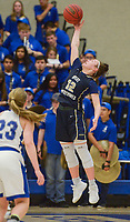 NWA Democrat-Gazette/CHARLIE KAIJO Bentonville West High School guard Kelsey Wood (12) reaches to catch a pass during a basketball game, Friday, February 8, 2019 at Rogers High School in Rogers.