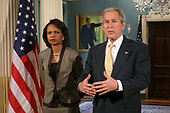 United States President George W. Bush, right, makes remarks to the press at the State Department, March 24, 2008 in Washington, DC, as US Secretary of State Condolezza Rice looks on. In his remarks the President thanked the employees of the State Department for their hard work. <br /> Credit: Ken Cedeno / Pool via CNP
