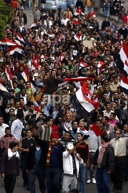 Egyptian anti-government protesters shout in front of Ettehadyya Presidential palace in Cairo, Egypt, Friday, Feb. 11, 2011. Egypt's military seemed to throw its weight Friday behind President Hosni Mubarak's plan to stay in office until September elections while protesters massed near the presidential palace in Cairo and other key symbols of the authoritarian regime in a new push to force the leader to step down immediately. Photo by Ahmed Asad