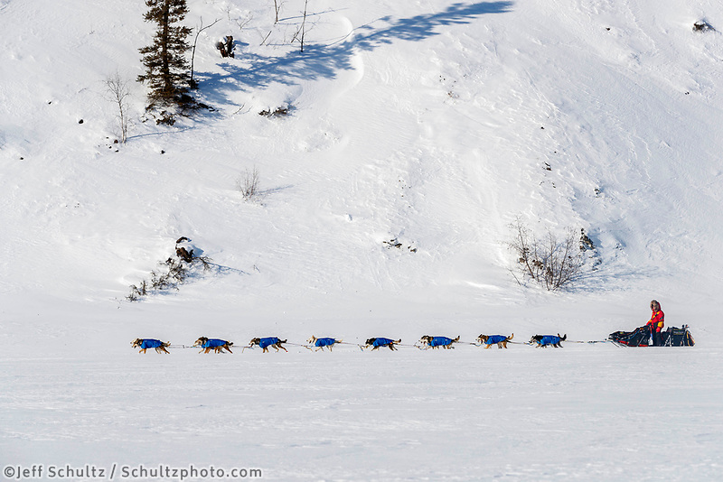 Mitch Seavey run next to cliffs on the trail on the Tanana River after leaving the Manley Hot Springs checkpoint during the 2017 Iditarod on Tuesday March 7, 2017.<br /> <br /> Photo by Jeff Schultz/SchultzPhoto.com  (C) 2017  ALL RIGHTS RESVERVED