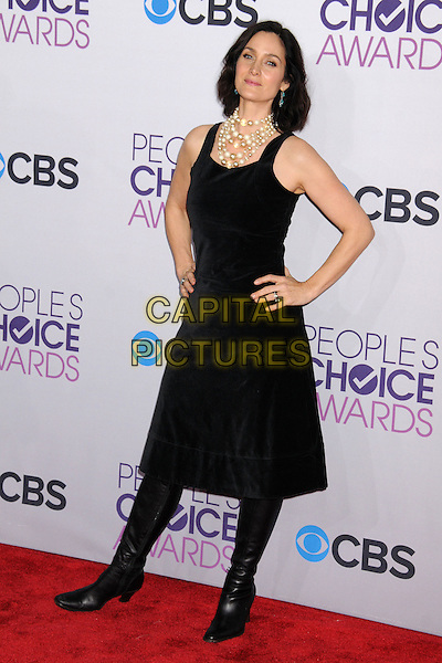 Carrie-Anne Moss.People's Choice Awards 2013 - Arrivals held at Nokia Theatre L.A. Live, Los Angeles, California, USA..January 9th, 2013.full length dress boots black sleeveless pearls necklace hands on hips.CAP/ADM/BP.©Byron Purvis/AdMedia/Capital Pictures.