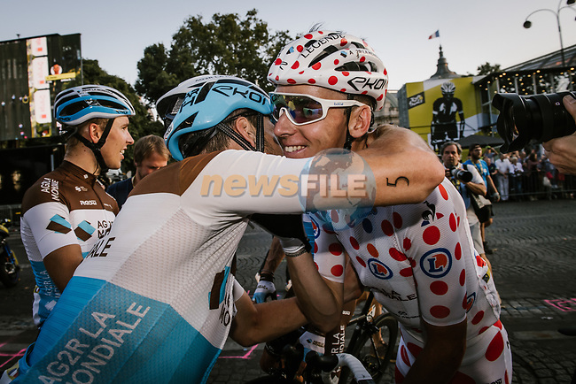 Romain Bardet (FRA) AG2R La Mondiale wins the mountains Polka Dot Jersey hugs his team mates at the end of Stage 21 of the 2019 Tour de France running 128km from Rambouillet to Paris Champs-Elysees, France. 28th July 2019.<br /> Picture: ASO/Pauline Ballet | Cyclefile<br /> All photos usage must carry mandatory copyright credit (© Cyclefile | ASO/Pauline Ballet)