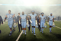 CHAPEL HILL, NC - NOVEMBER 02: Game captains Charlie Heck #67, Aaron Crawford #92, Jason Strowbridge #55, Dazz Newsome #5, and British Brooks #34 of the University of North Carolina walk to the middle of the field for the coin toss during a game between University of Virginia and University of North Carolina at Kenan Memorial Stadium on November 02, 2019 in Chapel Hill, North Carolina.