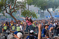 Rioters get rowdy on the downtown streets of Vancouver,BC after the Canucks were defeated by the Boston Bruins in the Stanly Cup on June 15, 2011. (photo copyright Karen Ducey)