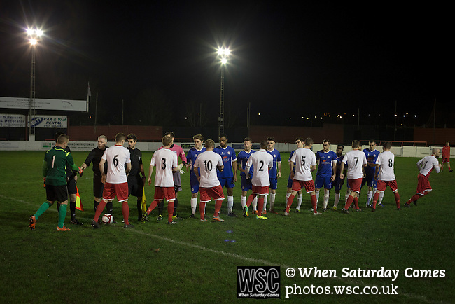 Ashton United 6 Ramsbottom United 0, 12/01/2016. Hurst Cross stadium, Northern Premier League. The two teams exchange handshakes before the fixture between Ashton United (in red) and Ramsbottom United in the Northern Premier League premier division. The match was played at Ashton's Hurst Cross stadium, the club's ground. The club was originally founded in 1878 as Hurst F.C. and by 1880 the club were playing at Hurst Cross, their current ground which makes their home one of the oldest football grounds in the world. Ashton won the match 6-0, watched by a crowd of 178. Photo by Colin McPherson.