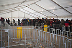 Refugees at the Landesamt für Gesundheit und Soziales (LaGeSo), the Berlin administration facility for health and social welfare, waiting in a queue inside one of the specially-constructed tents. The administration buildings and surrounding land became the main registration centre and first point of contact with the authorities for refugees arriving in Berlin from July 2015 onwards. Around 60,000 refugees arrived in the city in the first 10 months of 2015, out of an overall total of around 850,000 in the whole of Germany.