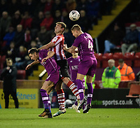 Lincoln City's Matt Rhead vies for possession with Carlisle United's Mike Jones, left, and Carlisle United's Gary Liddle<br /> <br /> Photographer Chris Vaughan/CameraSport<br /> <br /> The Emirates FA Cup Second Round - Lincoln City v Carlisle United - Saturday 1st December 2018 - Sincil Bank - Lincoln<br />  <br /> World Copyright © 2018 CameraSport. All rights reserved. 43 Linden Ave. Countesthorpe. Leicester. England. LE8 5PG - Tel: +44 (0) 116 277 4147 - admin@camerasport.com - www.camerasport.com