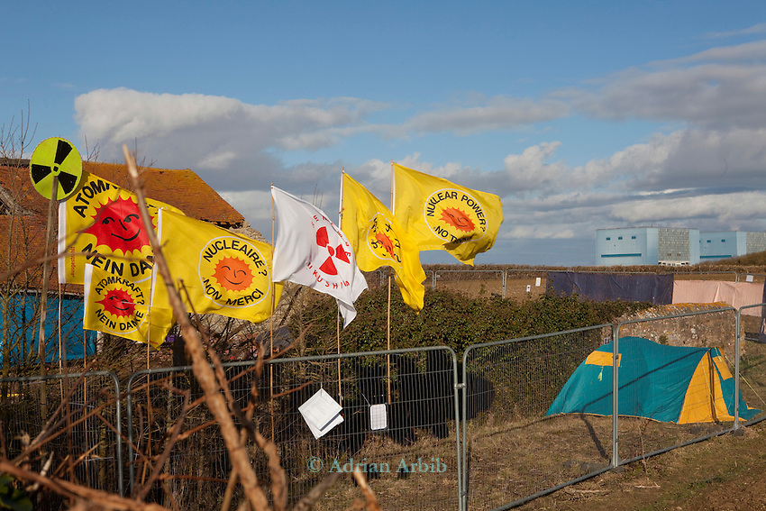 Anti nuclear protest at Hinkley Point north Somerset . Protesters have occupied a  farmhouse as EDF clear the land well  before  they have been given planning  permission for a  new power station at Hinkley C as part of  the UK  Government's new  nuclear plan.  2 thirds of  DECCs  budget is being spent on decomissioning  whilst the  other third is spent on subsidising nuclear .