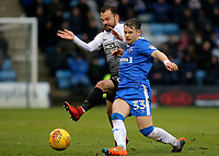 Danny Lloyd of Peterborough United and Gillingham's Mark Byrne challenge for the ball during Gillingham vs Peterborough United, Sky Bet EFL League 1 Football at the MEMS Priestfield Stadium on 10th February 2018