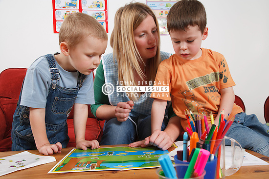 Nursery nurse playing with children