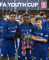 (L-r) Tino Anjorin, Callum Hudson-Odoi & Billy Gilmour of Chelsea U18 pose with the trophy during the FA Youth Cup FINAL 2nd leg match between Arsenal and Chelsea at the Emirates Stadium, London, England on 30 April 2018. Photo by Andy Rowland.