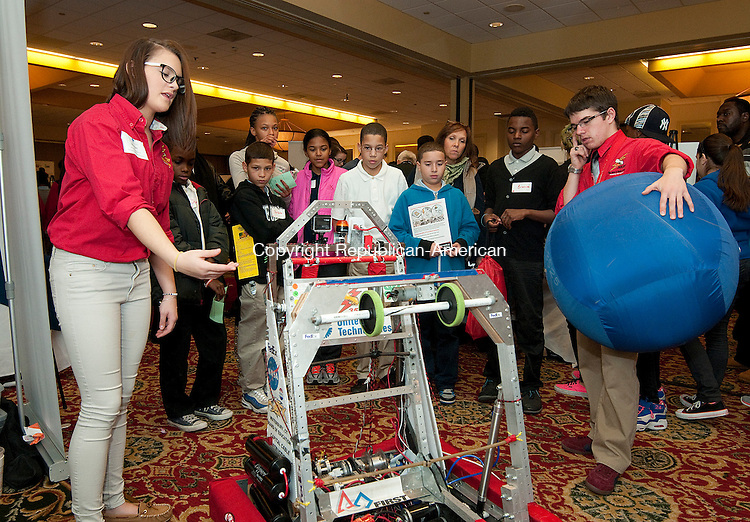 WATERBURY, CT-111814JS02- Kennedy High School students Morgan Fasanelli, left, and Andrew Work, both members of the school's robotics team, talks about the work that goes into building a robot and what they do during competition, to students during the 2014 STEM/Advanced Manufacturing &amp; Technology Expo at the Coco Key in Waterbury. The event, presented by the Waterbury Regional Chamber, hosted about 1800 middle and high school students from the region to learn about manufacturing as a career.  <br /> Jim Shannon Republican-American