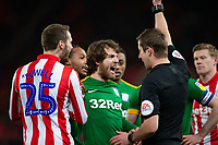 12th February 2020; Bet365 Stadium, Stoke, Staffordshire, England; English Championship Football, Stoke City versus Preston North End; Ben Pearson of Preston North End argues with the ref about a yellow card